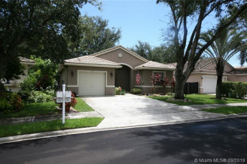 Home for Sale at 5441 NW 50th Ct, Coconut Creek FL 33073