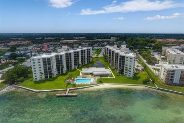 Home for Sale at 19800 Sandpointe Bay Dr #210, Tequesta FL 33469
