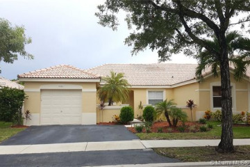 Home for Sale at 4180 Pine Ridge Ln, Weston FL 33331