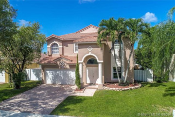 Home for Sale at 1040 NW 185th Ter, Pembroke Pines FL 33029