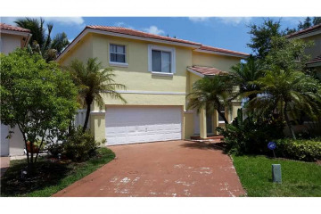 Home for Sale at 9810 SW 3rd St, Pembroke Pines FL 33025