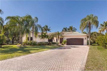Home for Sale at 129 Montclaire Dr, Weston FL 33326