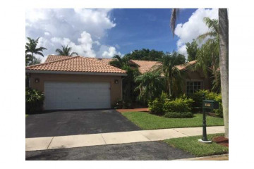 Home for Sale at 1146 Laguna Springs Dr, Weston FL 33326