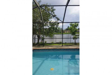 Home for Sale at 11650 NW 30 Place, Sunrise FL 33323