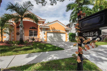 Home for Sale at 3884 Heron Ridge Ln, Weston FL 33331