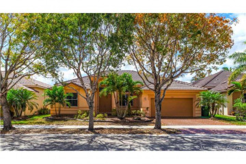 Home for Sale at 1353 Crossbill Ct, Weston FL 33327