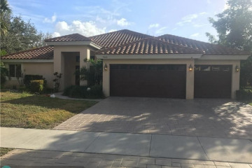 Home for Sale at 7410 NW 68th Way, Parkland FL 33067