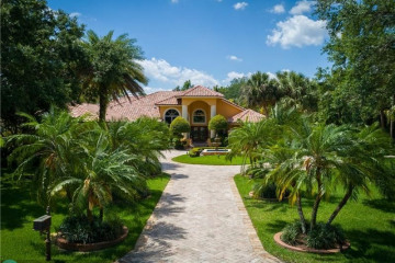 Home for Sale at 6980 NW 66th St, Parkland FL 33067