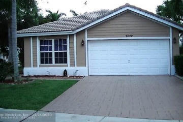 Home for Sale at 7022 NW 75th St, Parkland FL 33067