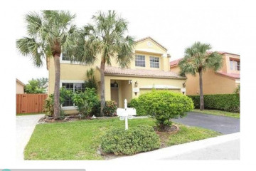 Home for Sale at 6415 NW 77th Place, Parkland FL 33067
