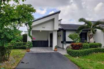 Home for Sale at 342 Fairway Cir #20, Weston FL 33326