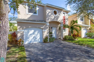 Home for Sale at 824 NW 99 Ave, Plantation FL 33324