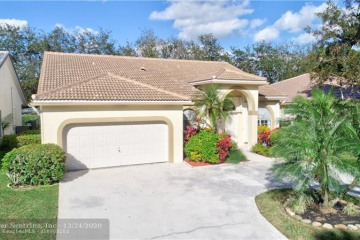 Home for Sale at 5959 NW 74th St, Parkland FL 33067