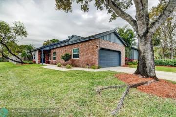 Home for Sale at 6510 Windsor Dr, Parkland FL 33067