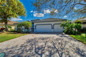 Home for Sale at 5984 NW 74th St, Parkland FL 33067