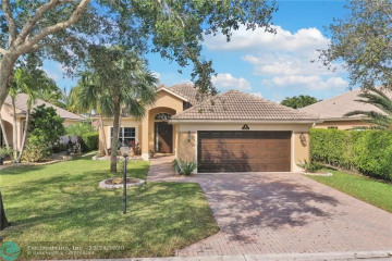 Home for Sale at 10960 NW 64th Dr, Parkland FL 33076