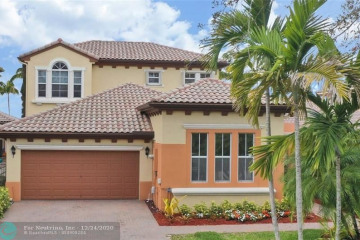Home for Sale at 6659 NW 128th Way, Parkland FL 33076