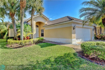 Home for Sale at 11309 NW 65th Mnr, Parkland FL 33076