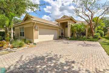 Home for Sale at 11194 NW 65th Ct, Parkland FL 33076
