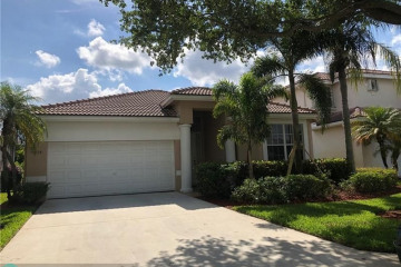 Home for Sale at 7714 NW 70th Way, Parkland FL 33067