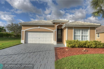 Home for Sale at 7027 NW 77th St, Parkland FL 33067