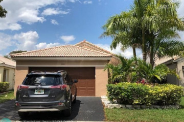 Home for Sale at 4349 Pine Ridge Ct, Weston FL 33331