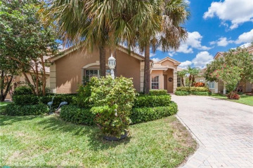 Home for Sale at 11207 NW 65th Ct, Parkland FL 33076