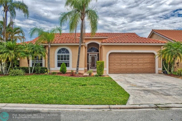 Home for Sale at 6045 NW 72nd Ct, Parkland FL 33067