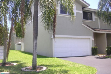 Home for Sale at 5414 Pointe Villa Dr, Lighthouse Point FL 33064