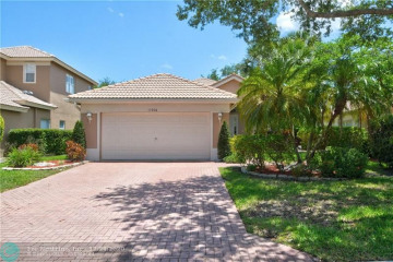 Home for Sale at 11006 NW 62nd Ct, Parkland FL 33076
