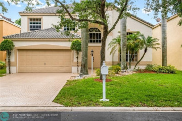Home for Sale at 6702 NW 80th Mnr, Parkland FL 33067