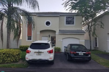Home for Sale at 9904 NW 2nd St, Plantation FL 33324