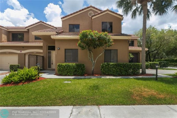 Home for Sale at 7525 NW 61 Terrace, Parkland FL 33067