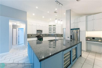 Home for Sale at 9603 Forest Ridge Cir, Davie FL 33328