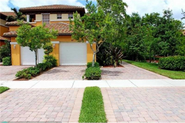 Home for Sale at 8117 NW 127th Ln #1-C, Parkland FL 33076