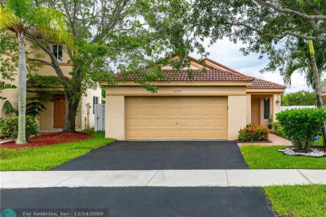 Home for Sale at 1459 Estancia Cir, Weston FL 33327