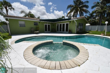Home for Sale at 5010 NE 23rd Ave, Lighthouse Point FL 33064