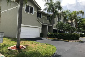 Home for Sale at 5418 Pointe Villa Dr, Lighthouse Point FL 33064