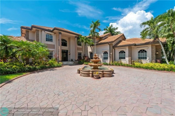 Home for Sale at 3845 Windmill Lakes Rd, Weston FL 33332