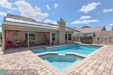 Home for Sale at 3311 NW 71st St, Coconut Creek FL 33073