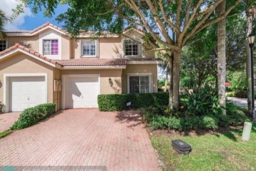 Home for Sale at 6151 NW 74th Ct #6151, Parkland FL 33067