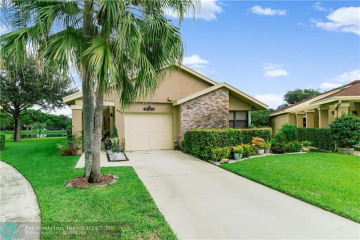 Home for Sale at 4819 Calamondin Cir, Coconut Creek FL 33063