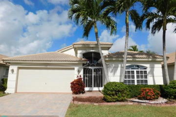 Home for Sale at 5909 Royal Isles Blvd, Boynton Beach FL 33437
