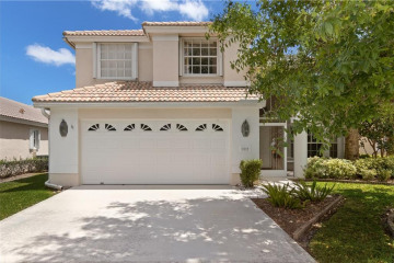 Home for Sale at 7079 SE Twin Oaks Circle, Stuart FL 34997