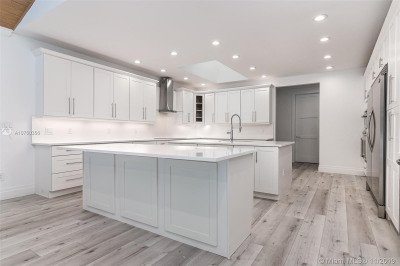 Brand New XXL open chef's kitchen featuring Top of the Line SS appliances, chrome finishes, custom wood shaker cabinets, quartz countertops and back splash, endless seating and storage!