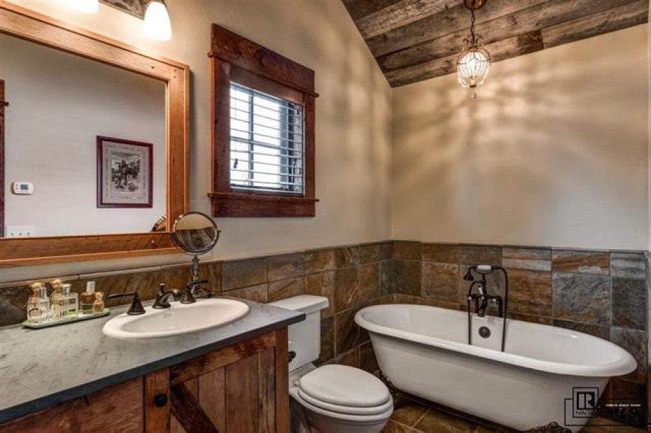 Just a slice of the old west in this claw foot tub. Included is also a gracious shower,double sinks