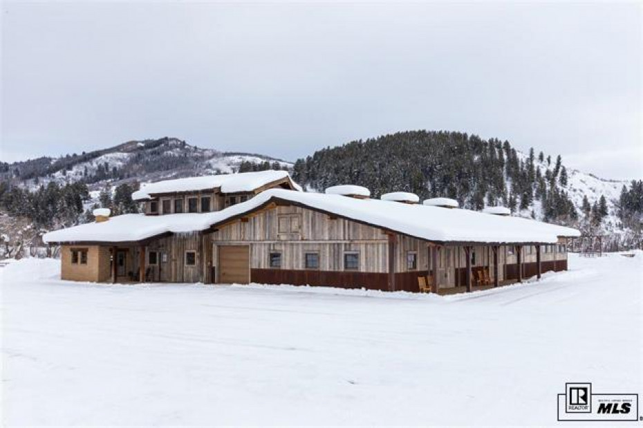 Beautifully designed and remodeled custom barn with a sensational office and caretakers apt.