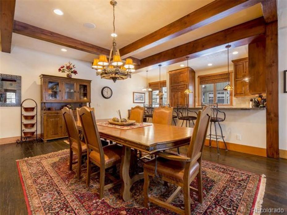 Custom kitchen offers granite counters, Wolf range and Subzero fridge.