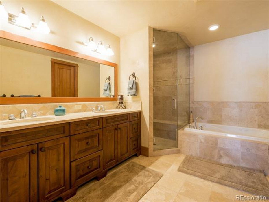 Master bath has dual sinks, jetted tub and steam shower.