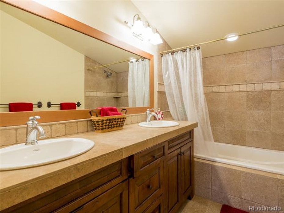 The junior master bath has dual vanities and a soaking tub.